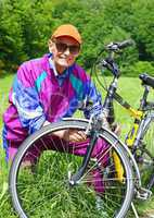 Senior with Bike in Nature - Senior mit Fahrrad