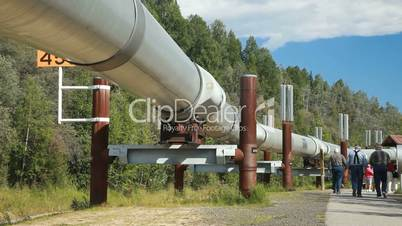 Alaska oil pipeline men walking P HD 7946