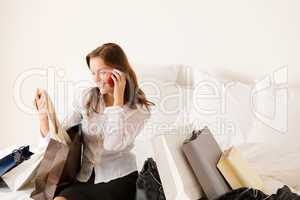 Woman on phone - back home from shopping