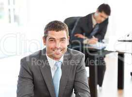 Happy businessman in the foreground during a meeting