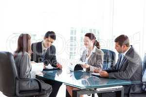 Four business people during a meeting