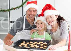 Happy woman with husband and daughter ith their biscuits ready