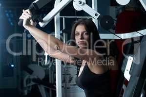 Young woman in sport club