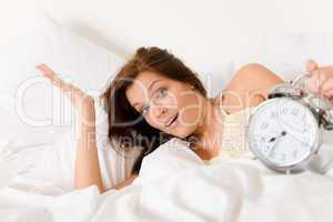 Bedroom - woman with alarm clock wake up