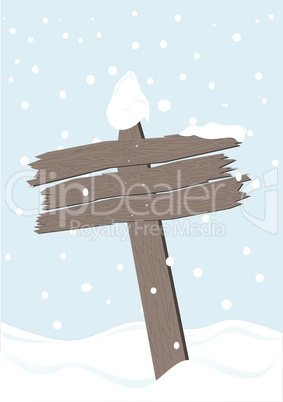 Old wooden sign with snow