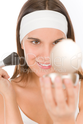 Make-up skin care - woman apply powder