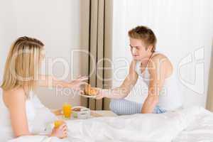 Luxury hotel honeymoon breakfast - couple in bed