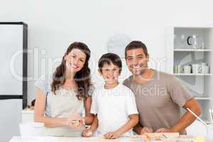 Portrait of a happy family preparing biscuits together