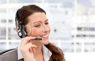 Pretty businesswoman with earpiece
