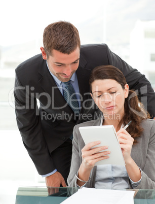 Handsome businessman speaking to a female colleague