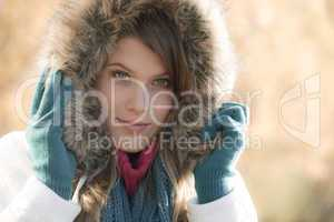 Winter fashion - woman with fur hood outdoors