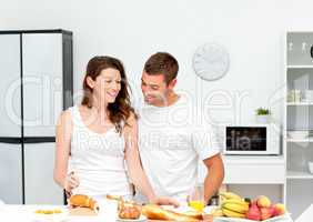 Lovely couple preparing their breakfast together