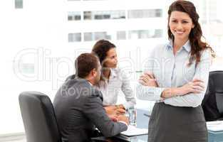 Happy businesswoman with her team during a meeting
