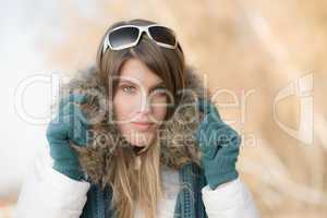 Winter fashion - woman with fur hood
