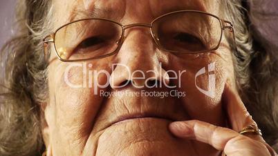 Senior old woman face wrinkle skin close up