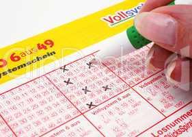 Lottoschein ausfüllen - Kugelschreiber