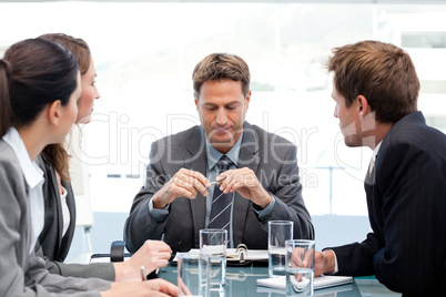 Serious manager at a table with his team during a meeting