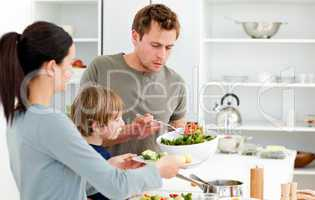 Dad serving salad to his family for lunch