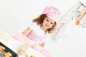 Portrait of a cute girl preparing cookies