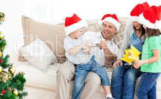 Father and son playing with a cracker on the sofa