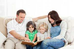 Happy family looking at a photo album together