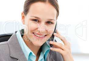 Young businesswoman on the phone with her cellphone