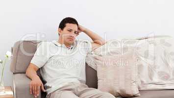 Depressed man thinking on the sofa