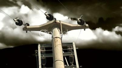 Elecricity pylon set against stormy lightning sky