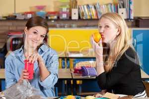 Schoolgirls preparing lunch