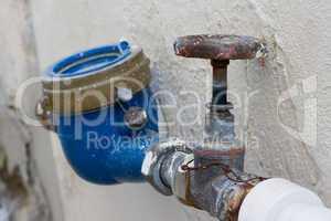 Rusting old water valve with water meter