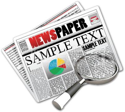 Zeitung und Lupe