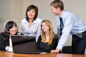 Businessgroup with laptop