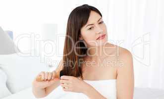 Beautiful woman brushing her hair