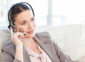 Businesswoman phoning in her living room