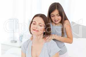 Lovely daughter brushing her woman hair