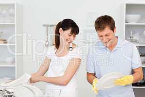 Lovers washing dishes together