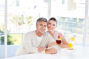 Happy couple drinking a glass