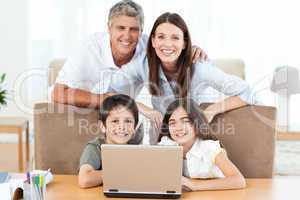 Joyful family looking at the camera
