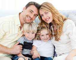 Cute family in their sofa