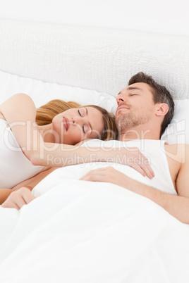 Happy couple sleeping together
