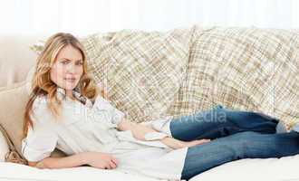 Wonderful woman lying down on her sofa