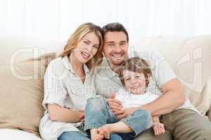 Happy family on their sofa