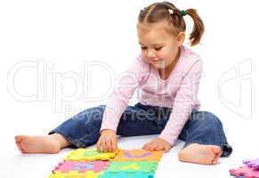 Little girl with alphabet
