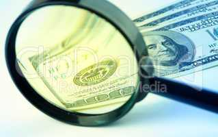 Dollars under a magnifying glass