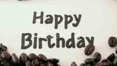 happy birthday.  written on white under coffee