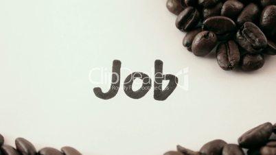 job.  written on white under coffee
