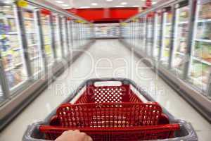 Fast Food Concept Motion Blur Shopping Trolley in Supermarket
