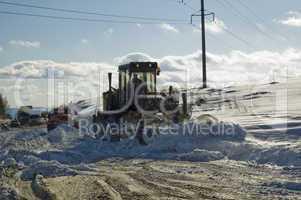 Grader removing snow