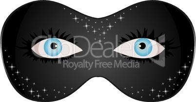 blue eyes hidden under theatrical mask