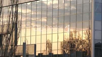 Reflection of urban sunset timelapse